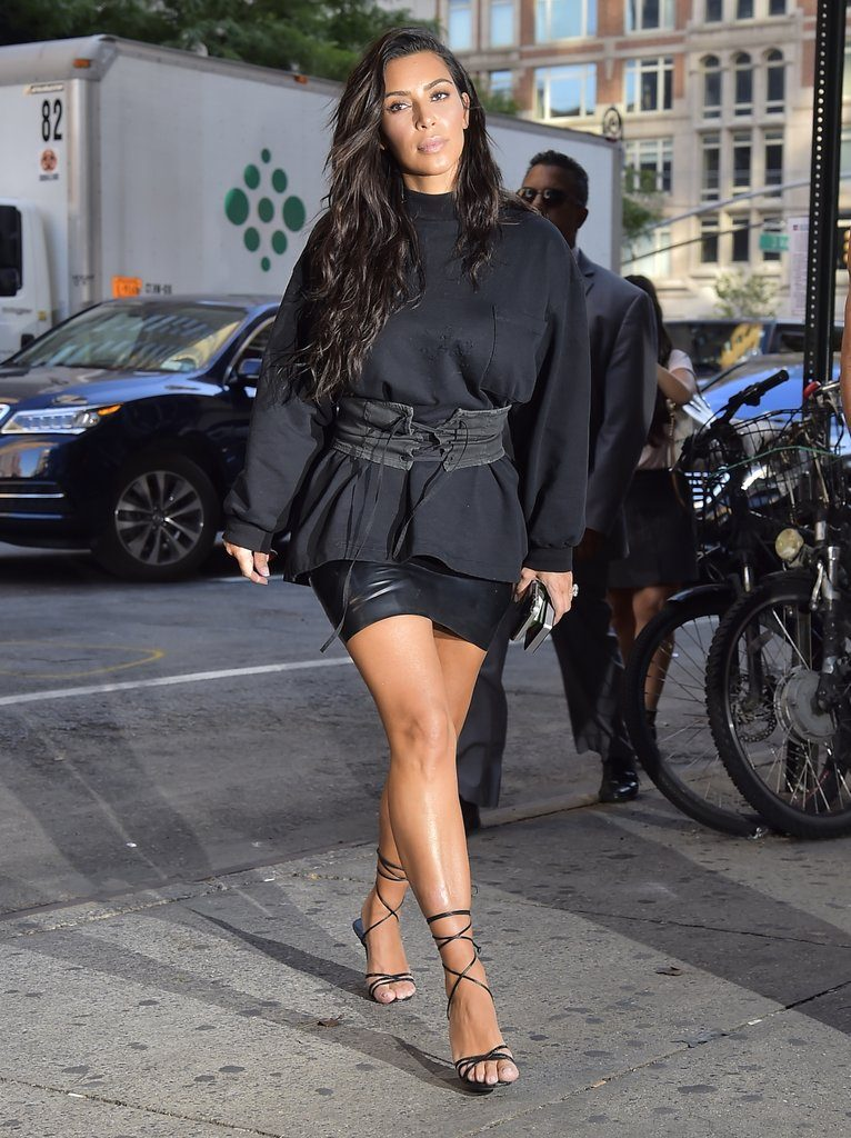 Kim-Wearing-Distressed-Long-Sleeved-Tee-Laced-Belt